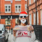 woman wearing Santa Claus mask