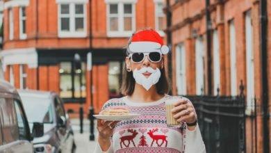 woman wearing Santa Claus mask